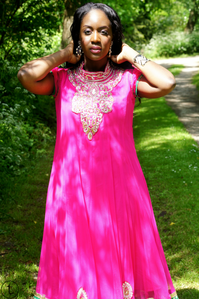 wearing a pink churidar with sequins indian dress