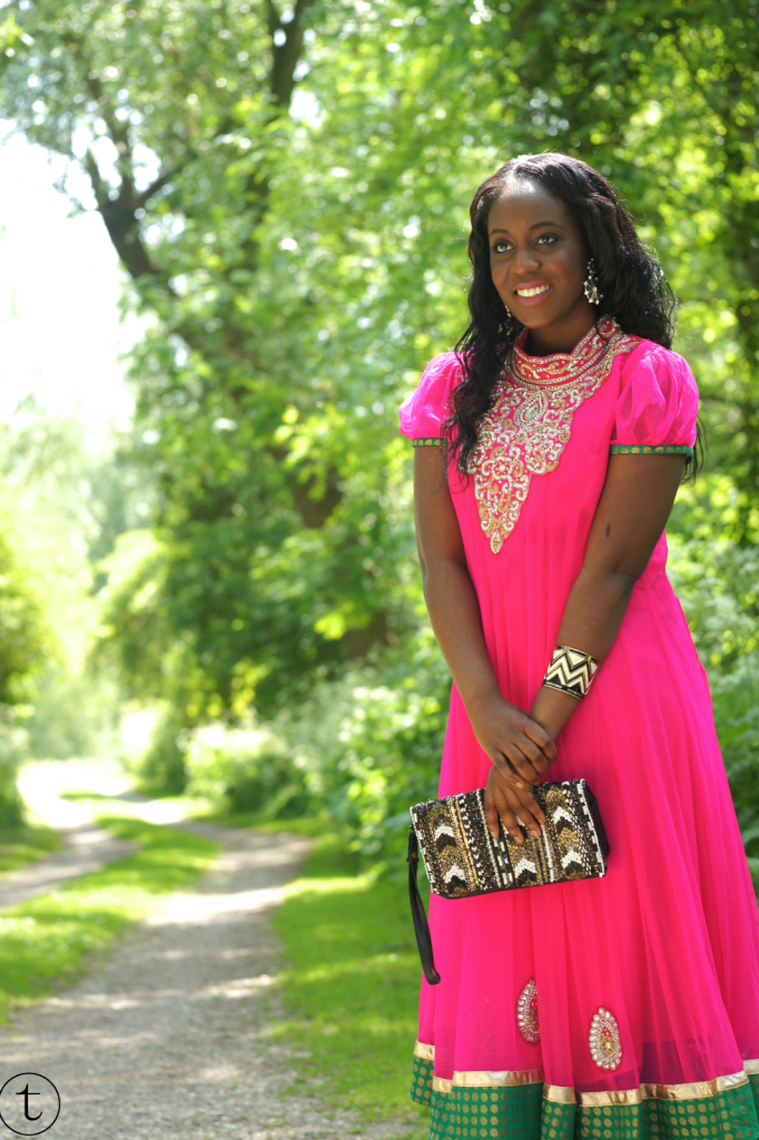 wearing a traditional indian dress pink churidar with sequins
