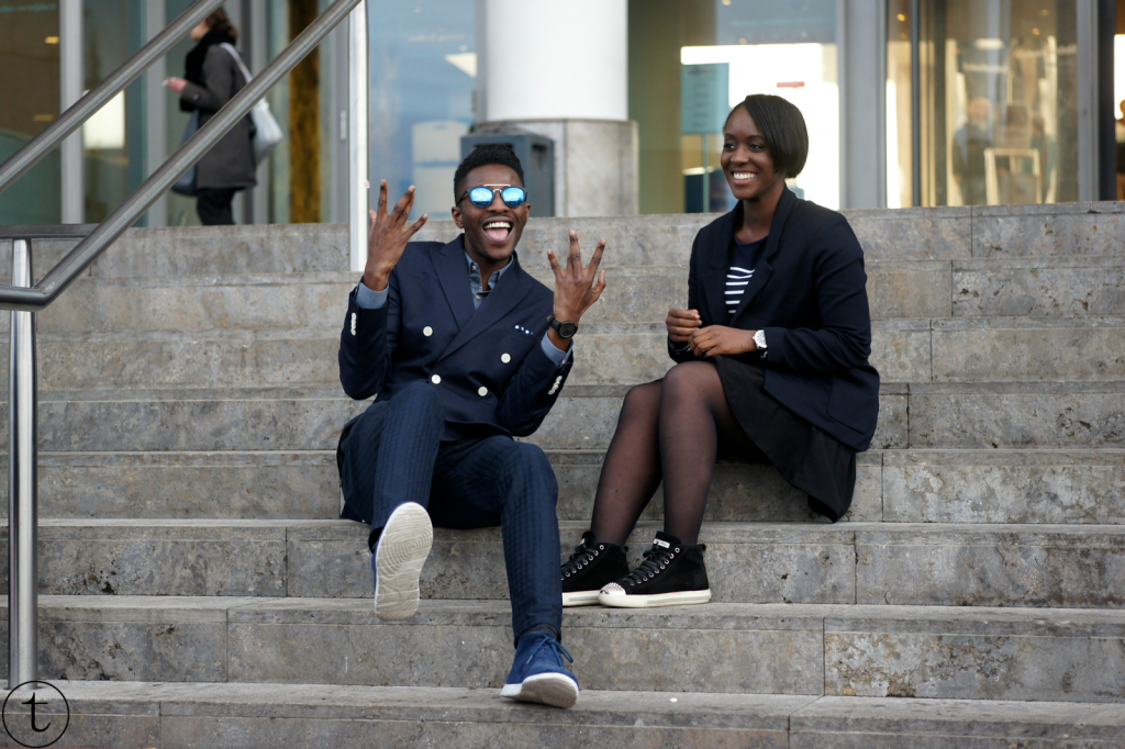outfit post with male blogger wearing navy blue and miu miu sneakers