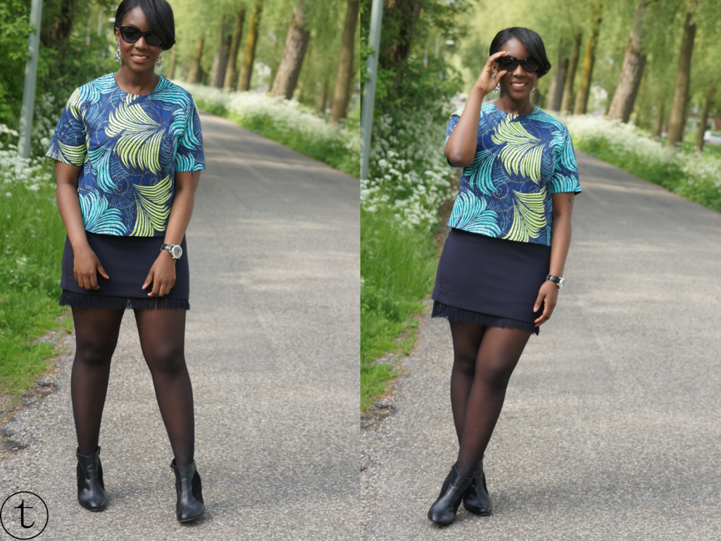 colorful h&m top with blue fringe skirt and cate eye sunglasses