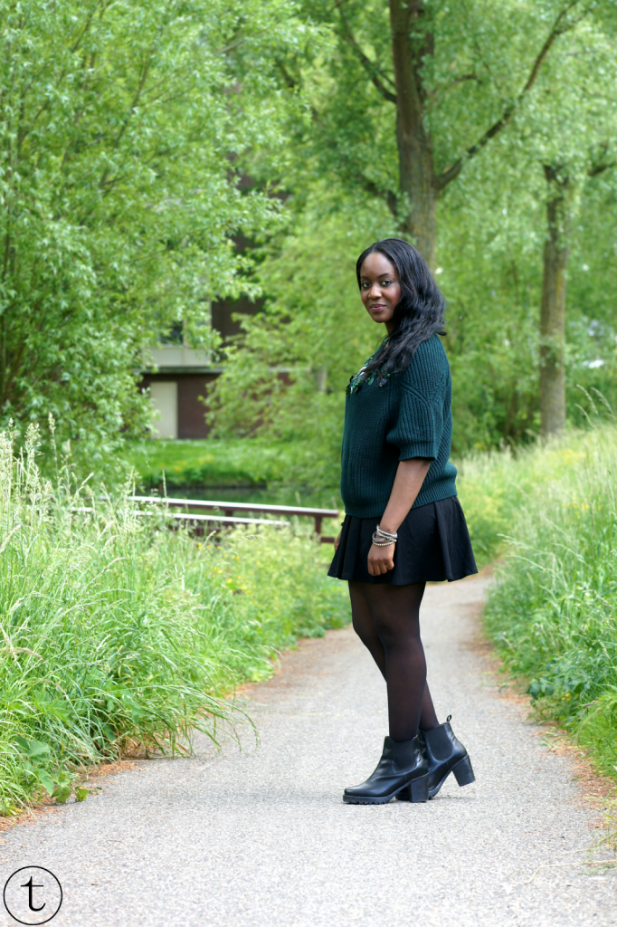 green h&m sweater and black skater skirt outfit post