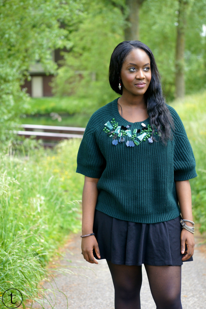 green h&m sweater with black skater skirt outfit post
