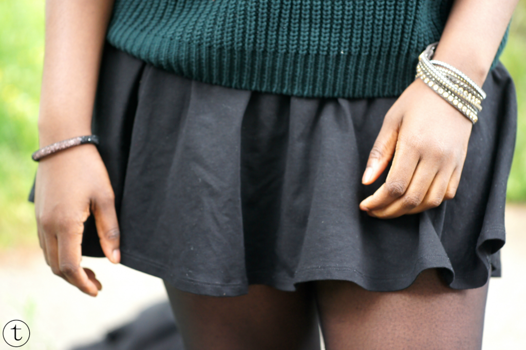 outfit of the day green sweater and black skater skirt