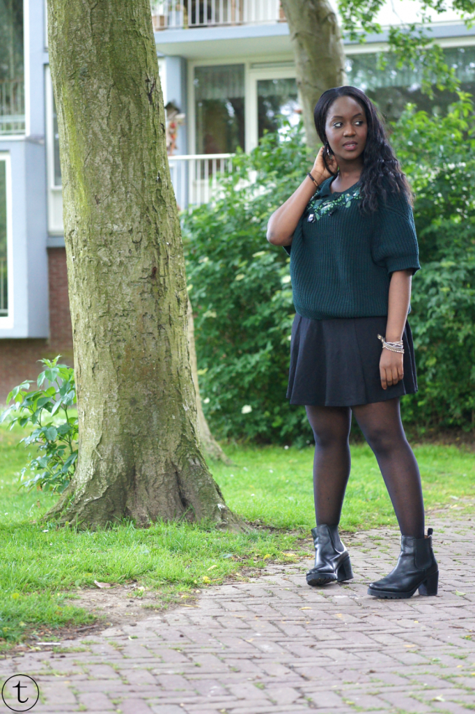 outift post green h&m sweater with black skater skirt