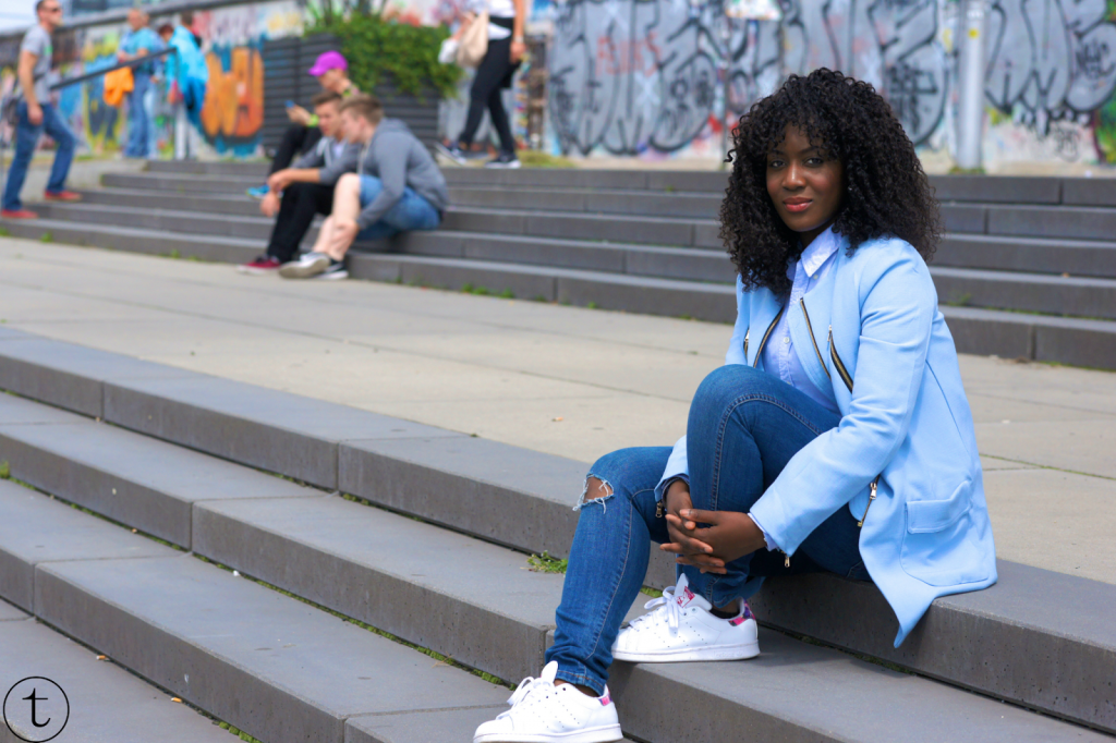 at the berlin wall wearing sheinside blue coat and ripped zara jeans outfit post
