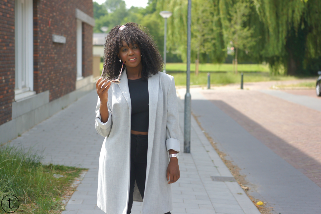 outfit post wearing a black crop top and a long grey coat