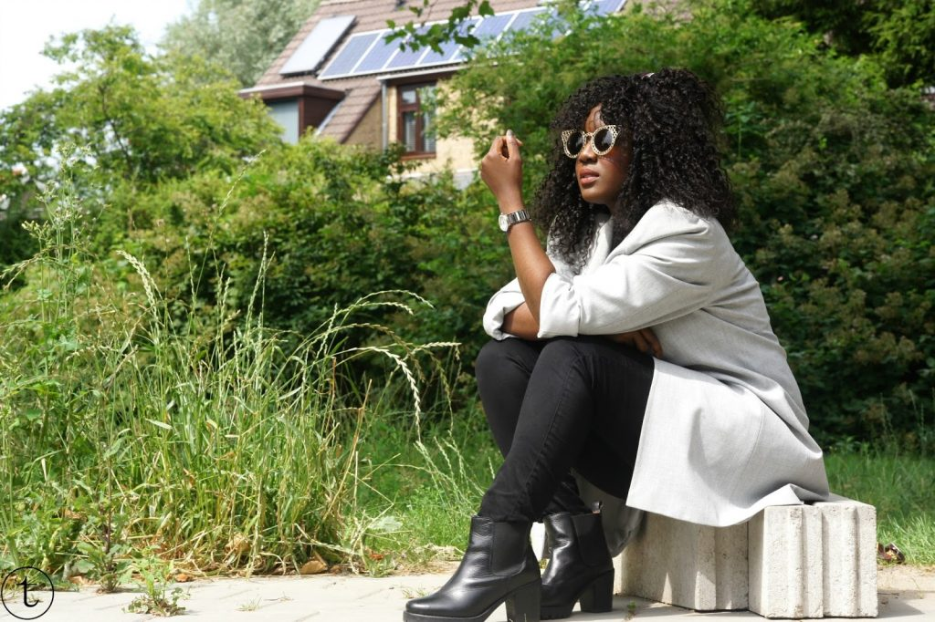 outfit post wearing black crop top and a long grey coat