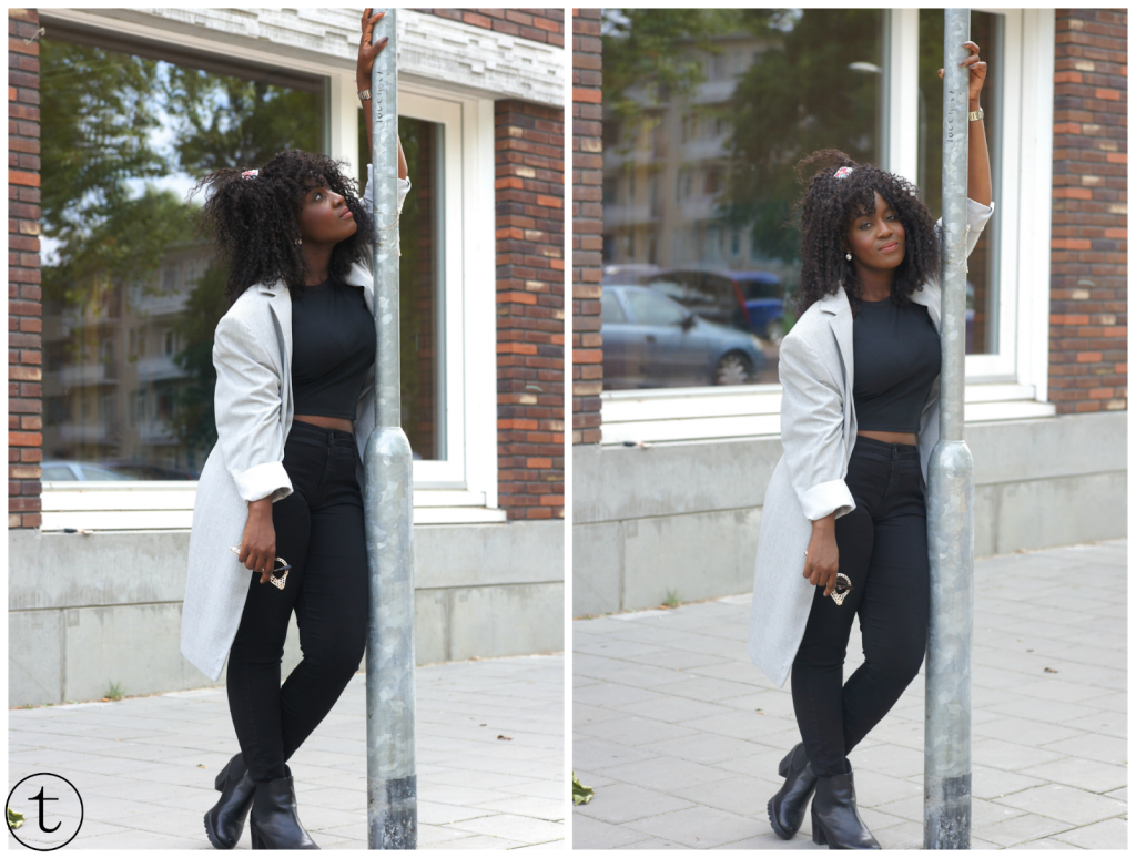 outfit post wearing black crop top and long grey coat