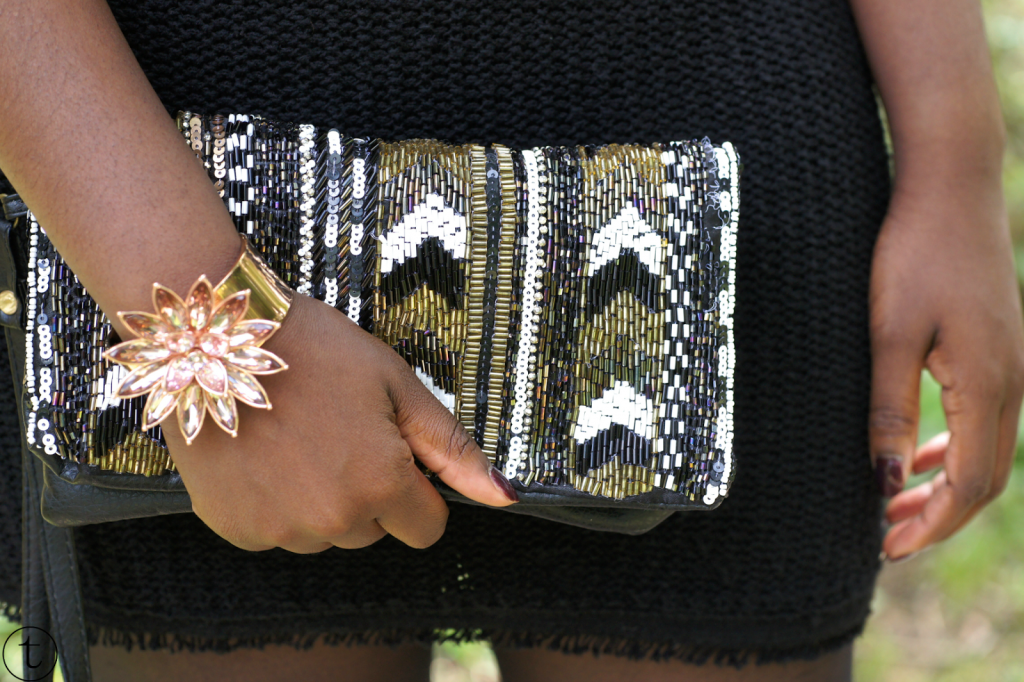 clutch with golden sequins and a rose gold bangle from ted baker