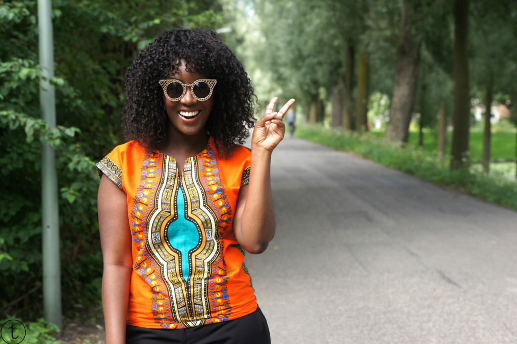 wearing an orange dashiki outfit of the day african wear african fashion
