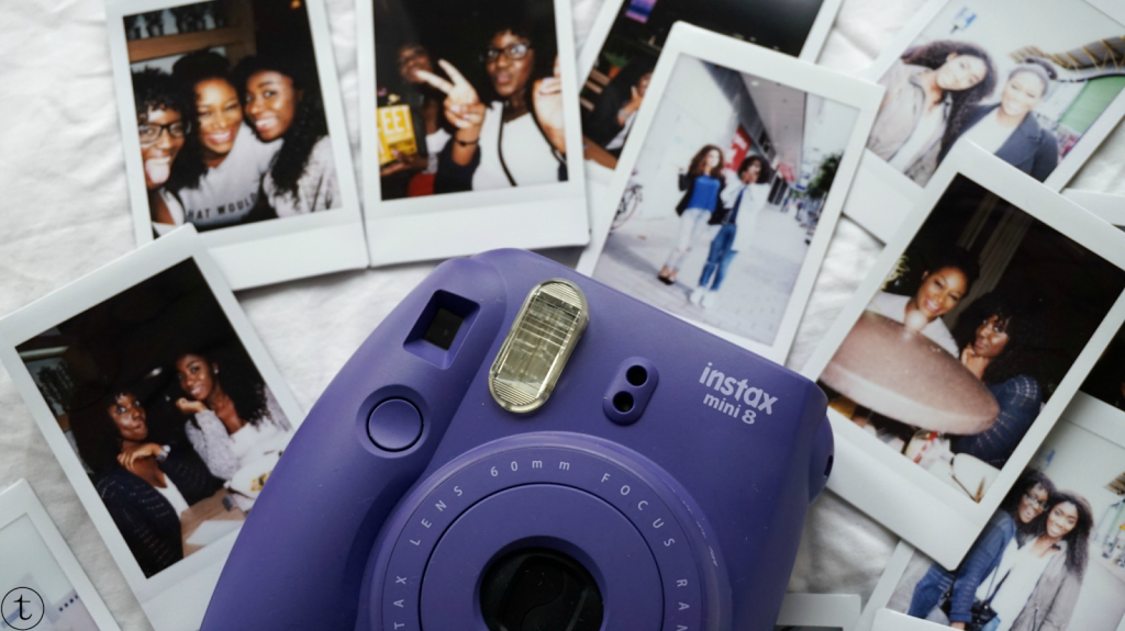 purple instax mini polaroid camera