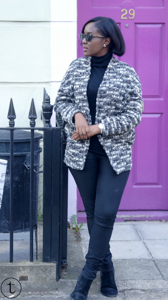 outfit post wearing a black turtle neck and grey chunky vest in london