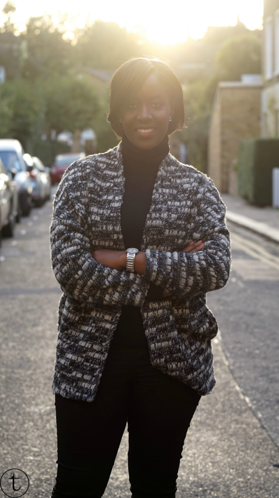 outfit post wearing black turtle neck and grey vest in camden town