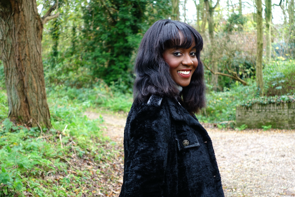 wearing a black coat from the united colors of benetton outfit post