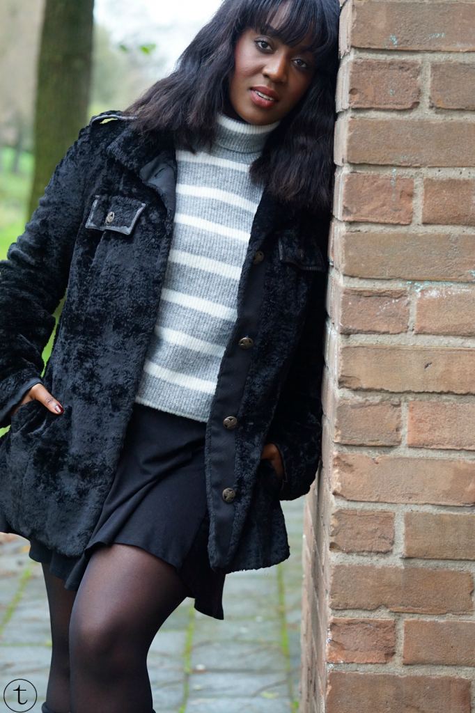 wearing a black coat from united colors of benetton and jumper from the mango