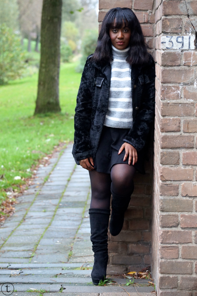 wearing a grey jumper from mango and black jacket from united colors of benetton