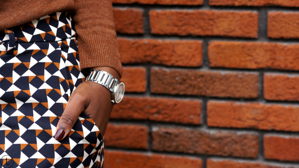 details wearing swarovski watch and h&m pants with prints