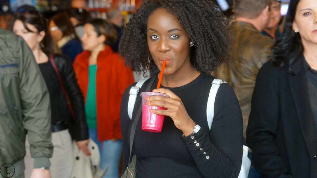 african fashion blogger travels to madrid, spain travel noire san miguel market